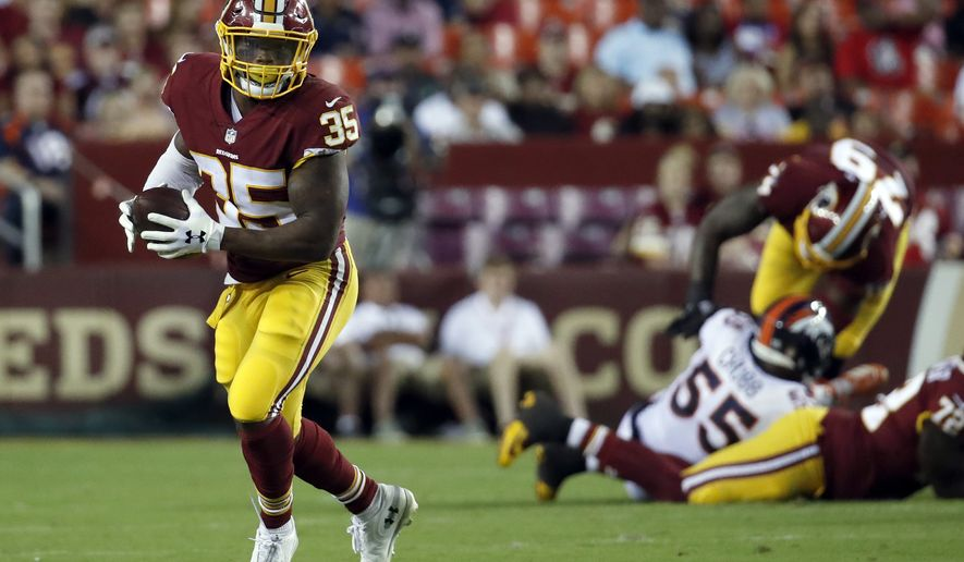Washington Redskins running back Kapri Bibbs (35) runs with the ball during the first half of a preseason NFL football game against the Denver Broncos, Friday, Aug. 24, 2018, in Landover, Md. (AP Photo/Alex Brandon)