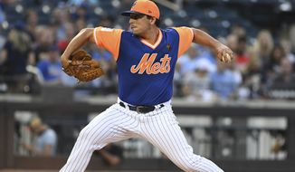 New York Mets starting pitcher Jason Vargas delivers against the against the Washington Nationals during the first inning of a baseball game Friday, Aug. 24, 2018, in New York. (AP Photo/Kathleen Malone-Van Dyke)