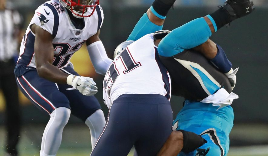 Carolina Panthers' Cam Newton, right, fumbles the ball as he lands on his head after being hit by New England Patriots' Deatrich Wise (91) during the first half of a preseason NFL football game in Charlotte, N.C., Friday, Aug. 24, 2018. The Panthers recovered the ball. (AP Photo/Jason E. Miczek)