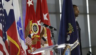 Command Sgt. Maj. Michael Crosby stands with the new Army Futures Command flag during an activation ceremony for the U.S. Army futures, Friday, Aug. 24, 2018, in Austin, Texas. The headquarters will be located at the University of Texas Systems Building in Austin. (AP Photo/Eric Gay) **FILE**