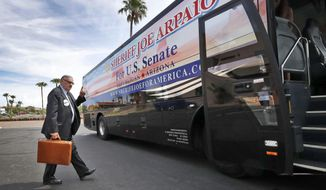 U.S. senatorial candidate and former Maricopa County Sheriff Joe Arpaio walks to his campaign tour bus Thursday, Aug. 23, 2018, in Fountain Hills, Ariz. Arpaio's Senate run will likely be the former sheriff's last political act, as he is expected to finish well outside the running in the GOP Senate primary. (AP Photo/Matt York)