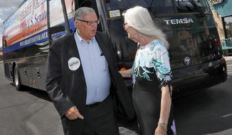 U.S. Senate candidate and former Maricopa County Sheriff Joe Arpaio is greeted by his wife, Ava, Thursday, Aug. 23, 2018, in Fountain Hills, Ariz., after a morning of campaigning throughout Maricopa County. Arpaio's Senate run will likely be the former sheriff's last political act, as he is expected to finish well outside the running in the GOP Senate primary. (AP Photo/Matt York)