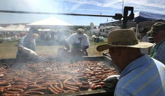 FILE--In this Aug. 15, 2015, file photo, dozens of Basque chefs tend the fire pits at the Inaugural Basque Fry at Corley Ranch in Gardnerville, Nev. White House counselor Kellyanne Conway and a slate of conservative officials and political figures will descent on a northern Nevada ranch Saturday, Aug. 25, 2018, for the 4th annual Basque Fry hosted by Republican Attorney General Adam Laxalt. (AP Photo/Lance Iversen, file)