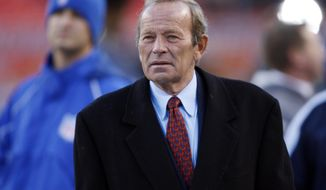 FILE - In this Oct. 21, 2007, file photo, Denver Broncos owner Pat Bowlen looks on during pre-game warmups before an NFL football game against the Pittsburgh Steelers in Denver. Bowlen's nomination for the Pro Football Hall of Fame is a jolt of good news for a franchise that's had little to cheer in the 30 months since winning Super Bowl 50. (AP Photo/David Zalubowski, File)