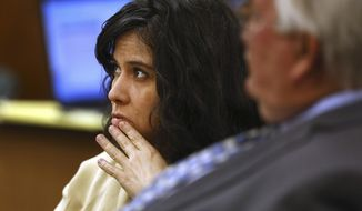 FILE - In this Dec. 2, 2015, file photo, Sophia Richter is shown at her trial on child abuse and kidnapping charges in Tucson, Ariz. She is accused of keeping her three daughters imprisoned in their Tucson home for three months. The Arizona Supreme Court on Friday, Aug. 24, 2018, threw out her convictions and ordered a new trial, saying the judge at her trial erred in barring her claims that she was compelled to commit the crimes by her husband's threats and immediate use of force. (Mike Christy/Arizona Daily Star via AP, File)