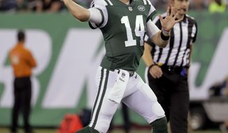 New York Jets quarterback Sam Darnold throws a pass against the New York Giants during the second quarter of an NFL preseason football game Friday, Aug. 24, 2018, in East Rutherford, N.J. (AP Photo/Julio Cortez)