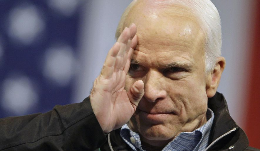 In this Oct. 30, 2008 file photo, Republican presidential candidate Sen. John McCain, R-Ariz., salutes to the crowd at a rally at Mentor High School in Mentor, Ohio. (Associated Press) **FILE**