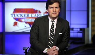 "FILE - In this March 2, 2017, file photo, Tucker Carlson, host of ""Tucker Carlson Tonight,"" poses for photos in a Fox News Channel studio in New York. Carlson says he's shocked his segments this week on a South African policy on land reform should be considered an appeal to white nationalists - let alone spark an international incident. (AP Photo/Richard Drew, File)"
