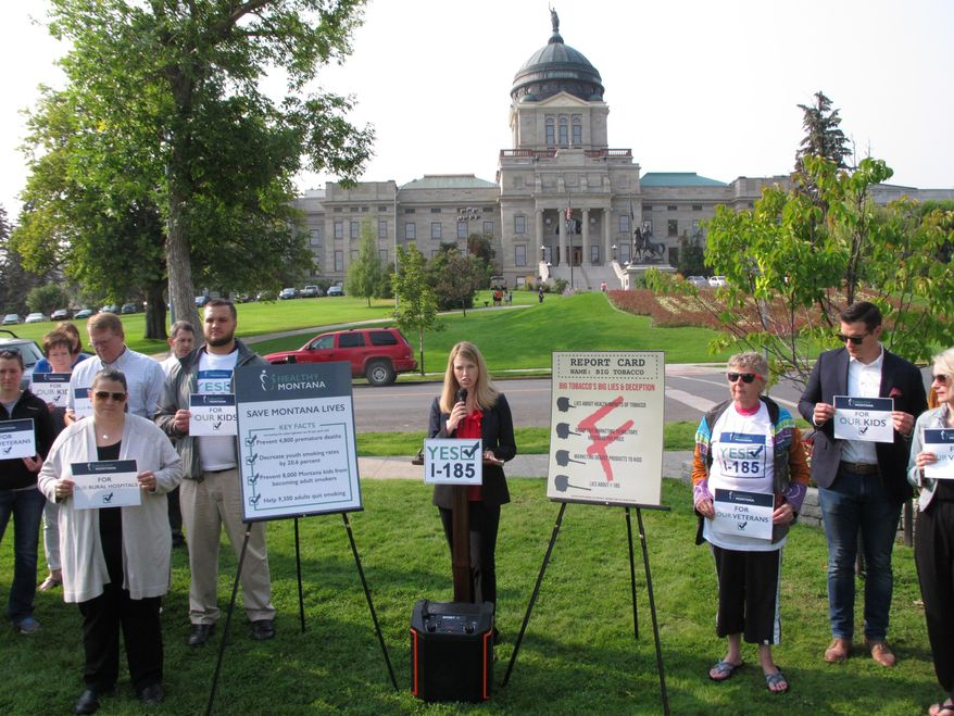 In this Wednesday, Aug. 22, 2018 photo, Amanda Cahill of the American Heart Association speaks to a rally in support of a ballot initiative to raise Montana's tobacco taxes in Helena, Mont. Cahill says the tobacco industry is attempting to deceive voters about the measure as an industry-funded group launches a massive ad blitz against the initiative. (AP Photo/Matt Volz)