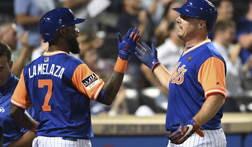 New York Mets 'Jose Reyes, left, greets Jay Bruce, who had hit a two-run home run against the Washington Nationals during the eighth inning of a baseball game Friday, Aug. 24, 2018, in New York. (AP Photo/Kathleen Malone-Van Dyke)