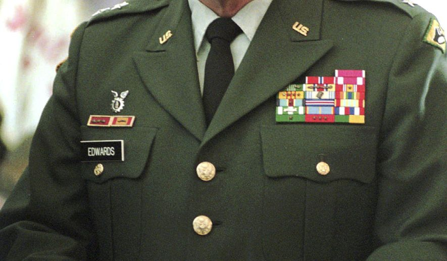 FILE - In this Feb. 20, 1997 file photo, United States National Guard Maj. Gen. Donald Edwards stands in the hall of the Vermont Statehouse in Montpelier, Vt. Edwards, the former adjutant general of the Vermont National Guard, died Aug. 16, 2018, at his home in South Bristol, Maine. He was 81. (AP Photo/Toby Talbot, File)