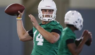 FILE - In this Thursday, Aug. 2, 2018, file photo, Oklahoma State quarterback Taylor Cornelius (14) throws during their first NCAA college football practice in Stillwater, Okla. Cornelius, a senior, was leading the pack at the end of the spring to become the starting quarterback. (AP Photo/Sue Ogrocki, File)