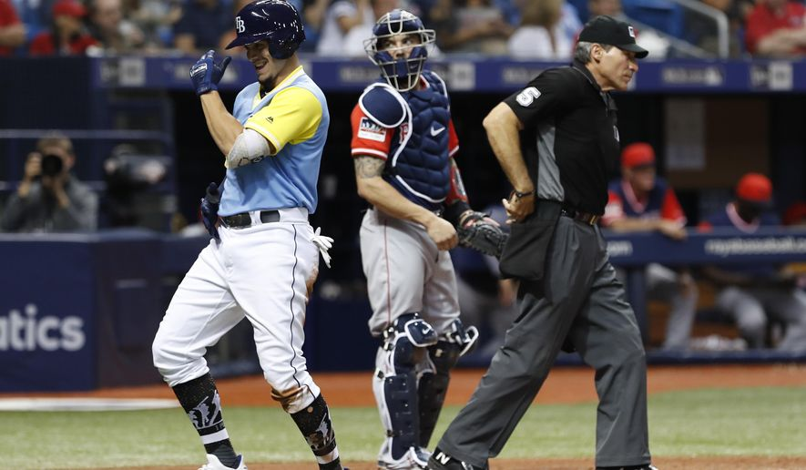 Tampa Bay Rays' Willy Adames, left, celebrates his two-run home run in front Boston Red Sox catcher Blake Swihart during the fourth inning of a baseball game on Friday, Aug. 24, 2018, in St. Petersburg, Fla. (AP Photo/Scott Audette)