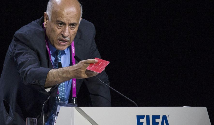 FILE - In this Friday, May 29, 2015 file photo Jibril Rajoub, president of the Palestinian Football Association speaks during the 65th FIFA Congress held at the Hallenstadion in Zurich, Switzerland. FIFA has banned the head of the Palestinian Football Association from attending soccer games for a year for inciting hatred and violence toward Lionel Messi. Jibril Rajoub called on Arab soccer fans to burn Messi posters and shirts if he participated in an Argentina game in Israel in June. (Patrick B. Kraemer/Keystone via AP, File)