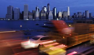 FILE- In this Nov. 1, 2012, file photo early morning traffic in New York's Brooklyn borough moves slowly beneath the Manhattan skyline. The Trump administration announced new rules Thursday, Aug. 23, 2018, aimed at preventing residents in high-tax states from avoiding a new cap on widely popular state and local tax deductions. (AP Photo/Mark Lennihan)