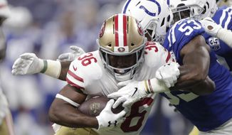 San Francisco 49ers running back Alfred Morris (36) is wrapped up by Indianapolis Colts linebacker Darius Leonard (53) during the first half of an NFL preseason football game in Indianapolis, Saturday, Aug. 25, 2018. (AP Photo/Michael Conroy)