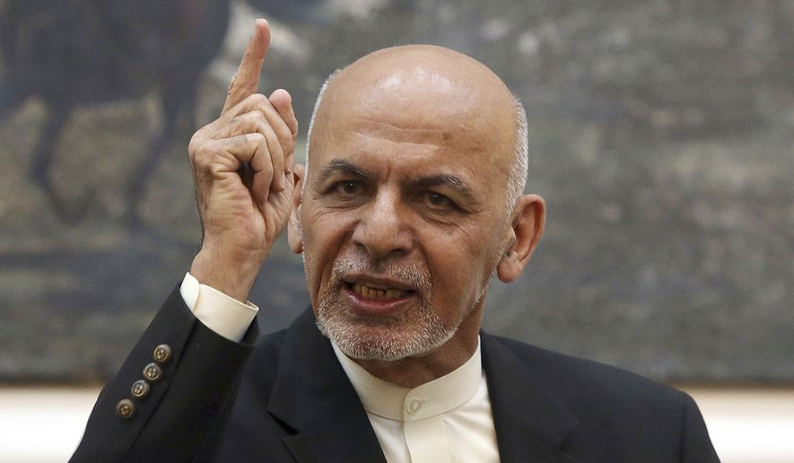 FILE - In this Sunday, July 15, 2018 file photo, Afghan President Ashraf Ghani speaks during a press conference at the presidential palace in Kabul, Afghanistan. Talks next month in Moscow to discuss a peaceful end to 17-years of war in Afghanistan that includes a place at the table for the Taliban has ruffled feathers in Washington and Kabul, who are refusing to attend, and resurrected Cold War memories. (AP Photo/Rahmat Gul) **FILE**