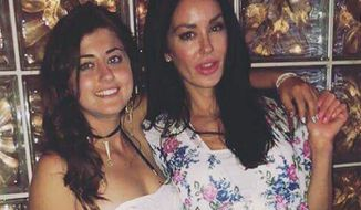 This undated photo provided by the Kraft family shows Kelsey Kraft, left, and her sister Christina Carlin-Kraft. Authorities say Christina Carlin-Kraft, a model found dead Wednesday, Aug. 22, 2018, in the bedroom of her apartment in Philadelphia's affluent Main Line suburb, was strangled. (Courtesy of the Kraft family via AP)