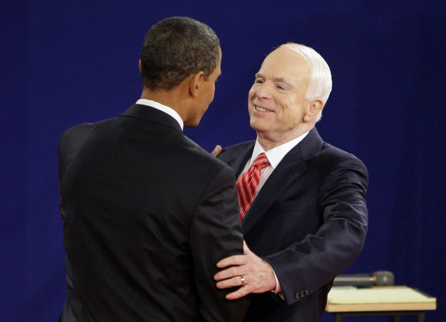 FILE - In this Oct. 7, 2008, file photo, Democratic presidential candidate Sen. Barack Obama, D-Ill., left, and Republican presidential candidate Sen. John McCain, R-Ariz., greet each other at the start of a townhall-style presidential debate at Belmont University in Nashville, Tenn. Aide says senator, war hero and GOP presidential candidate McCain died Saturday, Aug. 25, 2018. He was 81. (AP Photo/Mark Humphrey, File)