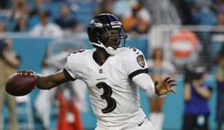 Baltimore Ravens quarterback Robert Griffin III passes during the first half of a preseason NFL football game against the Miami Dolphins, Saturday, Aug. 25, 2018, in Miami Gardens, Fla. (AP Photo/Brynn Anderson) **FILE**