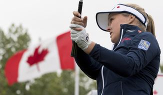 Brooke Henderson, of Smiths Falls, Ontario, tees off of the first hole during the women's Canadian Open golf tournament in Regina, Saskatchewan, Saturday, Aug. 25, 2018. (Jonathan Hayward/The Canadian Press via AP)