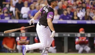 Colorado Rockies' Matt Holliday watches his solo home run against the St. Louis Cardinals during the seventh inning of a baseball game Saturday, Aug. 25, 2018, in Denver. (AP Photo/Joe Mahoney)