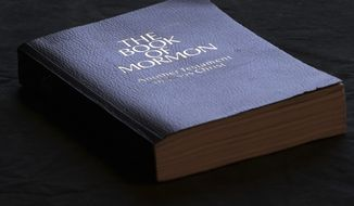 The Book of Mormon is shown Tuesday, Aug. 21, 2018, Salt Lake City. Sheraton, Westin and other Starwood hotels are finding their religion. Marriott International, which bought Starwood two years ago, has begun putting copies of the Bible and the Book of Mormon in Sheratons, Westins and other hotels in the Starwood family. (AP Photo/Rick Bowmer)