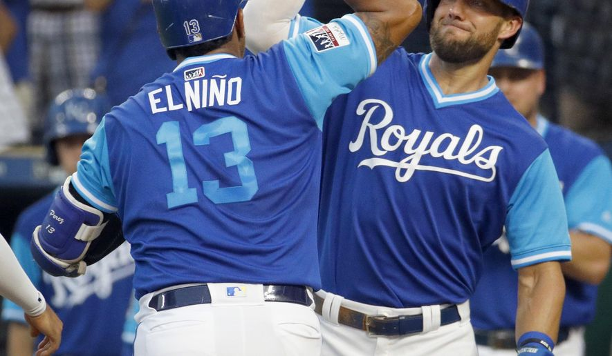 Kansas City Royals' Salvador Perez (13) celebrates with Alex Gordon after hitting a three-run home run during the first inning of a baseball game against the Cleveland Indians on Friday, Aug. 24, 2018, in Kansas City, Mo. (AP Photo/Charlie Riedel)