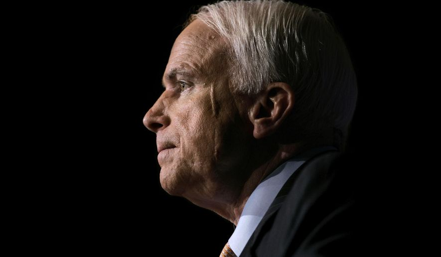 Sen. John McCain, R-Ariz., pauses while speaking to the GOPAC Fall Charter Meeting in Washington. McCain's family said in a statement on Aug. 24, 2018, the Arizona senator has chosen to discontinue medical treatment for brain cancer. The 81-year-old McCain has been away from the Capitol since December. McCain's face bears a scar from skin cancer surgery in 2000. (AP Photo/J. Scott Applewhite, file)
