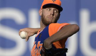 New York Mets pitcher Zack Wheeler delivers the ball to the Washington Nationals during the fourth inning of a baseball game Saturday, Aug. 25, 2018 in New York. (AP Photo/Bill Kostroun)