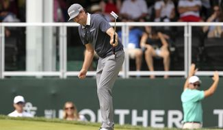 Keegan Bradley celebrates as he makes a putt on the 18th hole during the third round of the Northern Trust golf tournament, Saturday, Aug. 25, 2018, in Paramus, N.J. (AP Photo/Mel Evans)