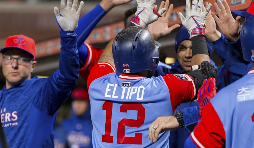 Texas Rangers' Rougned Odor celebrates in the dugout after hitting a two-run home run against the San Francisco Giants in the ninth inning of a baseball game in San Francisco, Friday, Aug 24, 2018. (AP Photo/John Hefti)