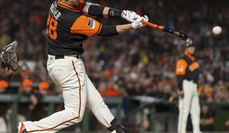 San Francisco Giants Buster Posey hits an RBI single against the Texas Rangers during the fourth inning of a baseball game in San Francisco, Friday, Aug 24, 2018. (AP Photo/John Hefti)