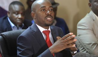 Zimbabwe opposition leader Nelson Chamisa addresses a media conference at the party headquarters in Harare, Saturday, Aug, 25, 2018. Chamisa said he respectfully rejects the court ruling upholding President Emmerson Mnangagwas narrow election win. (AP Photo/Tsvangirayi Mukwazhi)