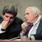 In this Dec. 1, 1992, photo, Sen. John Kerry, D-Mass., left, chairman of the Senate Select Committee on POW/MIA Affairs, listens to Sen. John McCain, R-Ariz., a former POW in Vietnam, during a hearing of the committee on Capitol Hill in Washington. Arizona Sen. McCain, the war hero who became the GOP's standard-bearer in the 2008 election, has died. He was 81. His office says McCain died Saturday, Aug. 25, 2018. He had battled brain cancer. (AP Photo/Ron Edmonds, File)