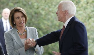 House Speaker Nancy Pelosi, D-Calif., left, greets Sen. John McCain, R-Ariz., right, following their meeting with President Barack Obama and Congressional leadership to discuss Afghanistan and Pakistan at the White House in Washington, Tuesday, Oct. 6, 2009. (AP Photo/Pablo Martinez Monsivais)