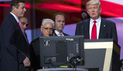 In this July 21, 2016, photo, then-Trump campaign manager Paul Manafort, left, and Manafort's chief deputy Rick Gates, center, watches as then-Republican presidential candidate Donald Trump rehearses for the Republican National Convention in Cleveland. President Donald Trump's former campaign chairman, Manafort, and Gates, a former Manafort business associate, have been indicted on Oct. 30, 2017, on charges of conspiracy against the United States and other counts. (AP Photo/Evan Vucci)