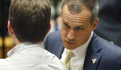 In this photo taken April 3, 2016, Corey Lewandowski talks to a member of the media at Nathan Hale High School in West Allis, Wis. (AP Photo/Charles Rex Arbogast)