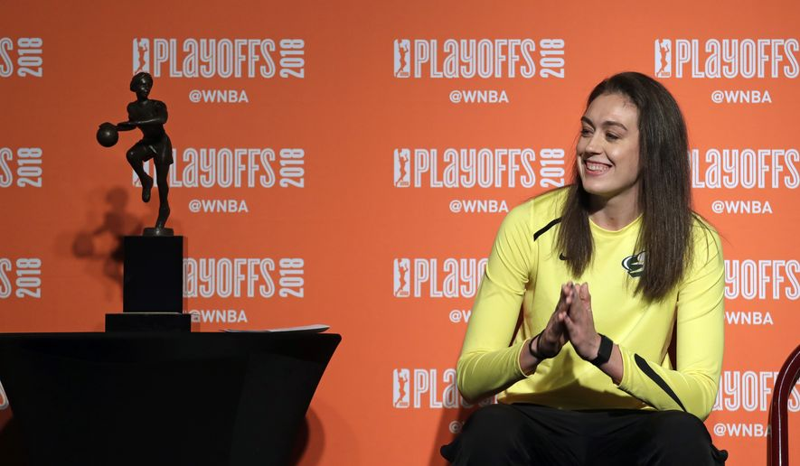 Seattle Storm's Breanna Stewart smiles as she is introduced before receiving the league's Most Valuable Player award before a semifinal basketball playoff game against the Phoenix Mercury Sunday, Aug. 26, 2018, in Seattle. (AP Photo/Elaine Thompson)