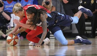 Atlanta Dream forward Jessica Breland, right, turns it over to Washington Mystics forward Elena Delle Donne during the second half of a WNBA basketball playoff semifinal, Sunday, Aug. 26, 2018, in Atlanta. (Curtis Compton/Atlanta Journal-Constitution via AP) ** FILE **