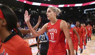 Washington Mystics forward Elena Delle Donne, who led the team with 32-points, and teammates celebrate an 87-84 victory over the Atlanta Dream in the opening game of a WNBA basketball playoffs semifinal, Sunday, Aug. 26, 2018, in Atlanta. (Curtis Compton/Atlanta Journal-Constitution via AP)