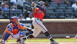 Washington Nationals' Wilmer Difo, right, hits a two-run home run against the New York Mets during the eighth inning of a baseball game Sunday, Aug. 26, 2018, in New York. (AP Photo/Rich Schultz)