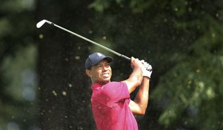 Tiger Woods watches his shot on the sixth hole during the final round of the Northern Trust golf tournament, Sunday, Aug. 26, 2018, in Paramus, N.J. (AP Photo/Mel Evans) ** FILE **