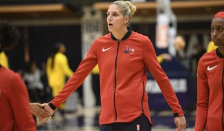 Washington Mystics guard Elena Delle Donne warms up before a single elimination WNBA basketball playoff game against the Los Angeles Sparks, Thursday, Aug. 23, 2018, in Washington. (AP Photo/Nick Wass) ** FILE **