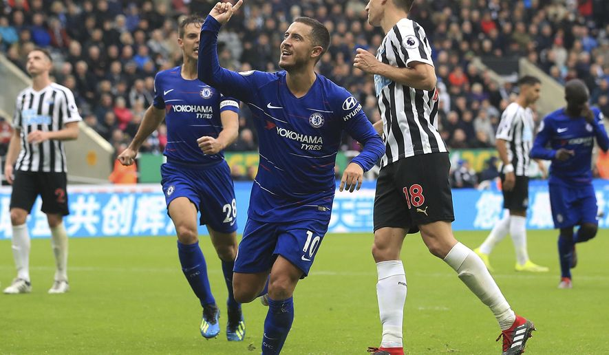 Chelsea's Eden Hazard, centre, celebrates scoring his side's first goal of the game against Newcastle, during their English Premier League soccer match at St James' Park in Newcastle, England, Sunday Aug. 26, 2018. (Owen Humphreys/PA via AP)