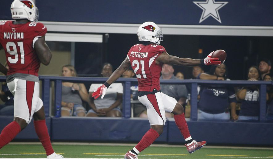 Arizona Cardinals defensive back Patrick Peterson (21) runs into the end zone with a touchdown followed by teammate Benson Mayowa (91) after an interception during the first half of a preseason NFL football game against the Dallas Cowboys in Arlington, Texas, Sunday, Aug. 26, 2018. (AP Photo/Michael Ainsworth)