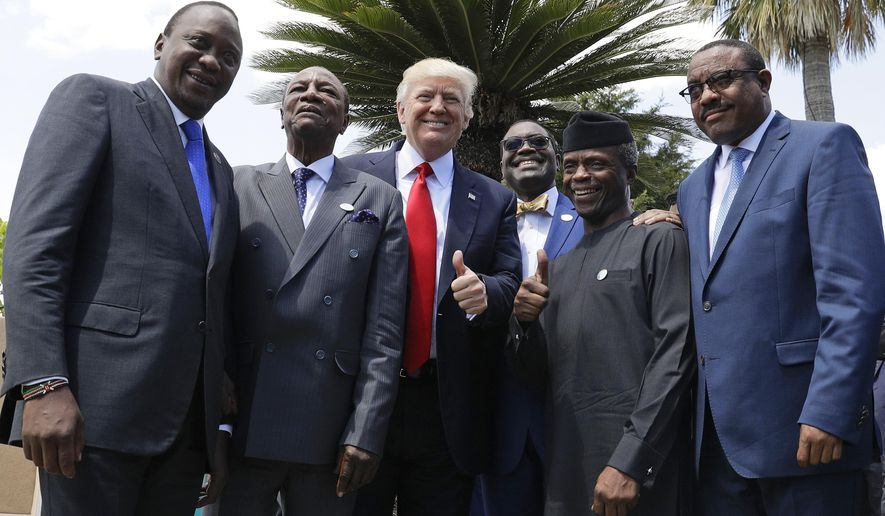 FILE - In this Saturday, May 27, 2017 file photo, U.S. President Donald Trump poses with African leaders, from left, Kenya's President Uhuru Kenyatta, President of the African Union Alpha Conde, President of the African Development Bank Akinwumi Adesina, Nigeria's Vice President Yemi Osinbajo and Ethiopia's then Prime Minister Hailemariam Desalegn, in the Sicilian town of Taormina, Italy. Kenya's president will meet with President Donald Trump on Monday, Aug. 27, 2018 as East Africa's commercial hub emerges from electoral turmoil. (AP Photo/Andrew Medichini, File)