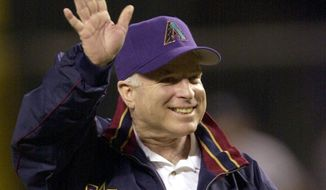 FILE - In this Nov. 4, 2001, file photo, Republican presidential candidate Sen. John McCain, R-Ariz., waves to the crowd prior to Game 7 of the World Series between the Arizona Diamondbacks and the New York Yankees at Bank One Ballpark in Phoenix. The sight of McCain sitting in the stands at Chase Field, formerly Bank One Ballpark, became so commonplace few people seemed to even notice. The senator from Arizona would get handshakes and take pictures with fans, but he was there just to be one of them, cheering on the home team. McCain died Saturday, Aug. 25, 2018, after battling brain cancer and the Arizona sports community mourned him across the Valley of the Sun. He was 81. (AP Photo/John Bazemore) ** FILE **