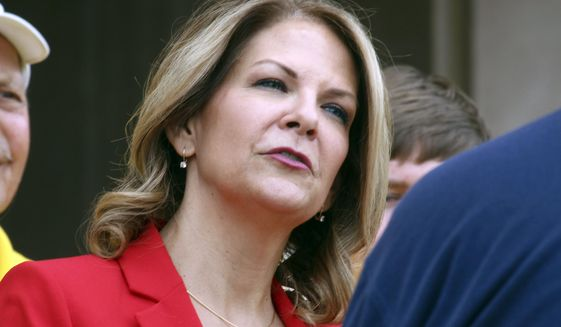 In this May 2, 2018 file photo, Arizona Republican U.S. Senate candidate Kelli Ward speaks to the media as she prepares to file her nominating petitions at the state Capitol in Phoenix. Ward, running for her party's nomination for an open Senate seat, suggested the announcement that McCain was ending medical treatment was intended to hurt her campaign hours before Sen. John McCain died on Saturday, Aug. 25. (AP Photo/Bob Christie, File)