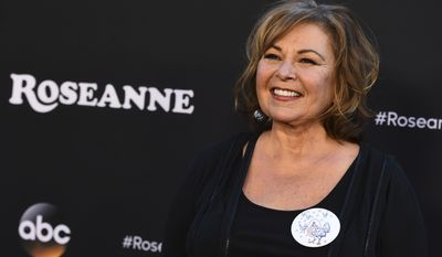 "Roseanne Barr arrives at the Los Angeles premiere of ""Roseanne"" on Friday, March 23, 2018 in Burbank, Calif. (Photo by Jordan Strauss/Invision/AP)"